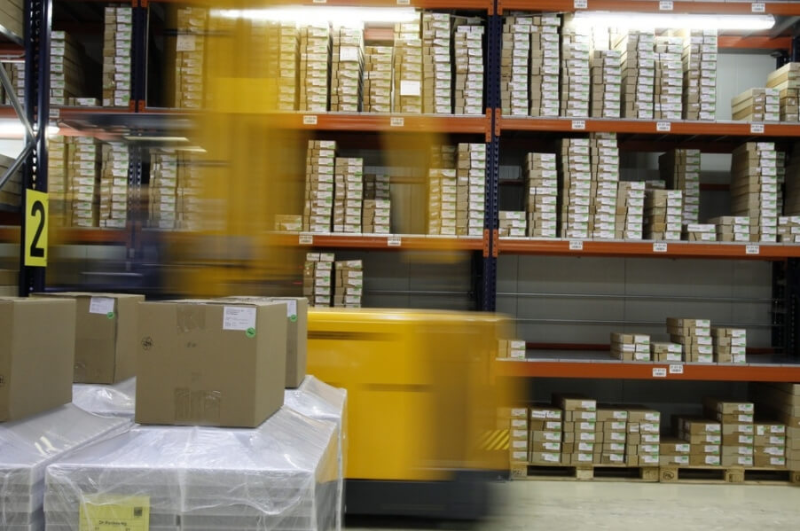 product packaging sitting on shelf with forklift