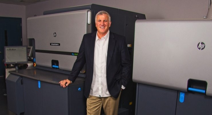 John Palica standing next to the new HP Indigo 6900 Digital Press